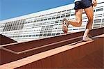 Man running up brick stair railing