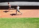 Men running on brick sidewalk