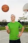 Man Tossing Basketball