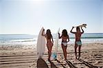 Women with Surf Boards, Zuma Beach, California, USA