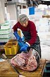 Man Working at Tsukiji Central Wholesale Market, Tokyo, Japan