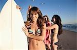 Young Women on Beach with Surfboards, Zuma Beach, California, USA
