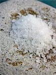 Coarse sea salt on a stone