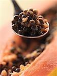 Papaya seeds on spoon (close-up)
