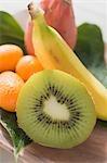 Exotic fruit still life with kiwi fruit, kumquats, banana
