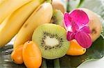 Bananas, kiwi fruit, kumquats and orchid