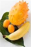 Banana, kiwano and kumquats on leaf