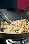 Frying vegetable rice in wok