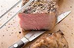 Grilled beef steak, a piece cut off