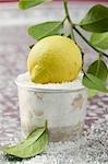 Fresh lemon in a dish of salt
