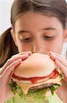 Little girl eating cheeseburger