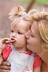 Little girl eating nut chocolate