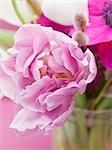 Pink tulip in vase of spring flowers