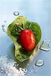 Grape tomato on a basil leaf with sea salt