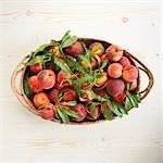 Organic peaches in a basket