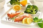 Raw fillet of wild salmon, broccoli, lemon