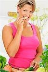 Woman eating organic cucumber