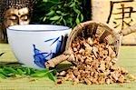Cup of tea and dried pagoda tree fruit (Chuan Lian Zi, China)