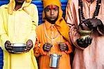 Close-up of saints holding kamandals, Pushkar, Ajmer, Rajasthan, India
