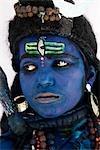Close-up of a boy dressed as Hindu god Shiva