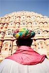 Man in front of a palace, Hawa Mahal, Jaipur, Rajasthan, India