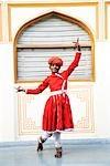 Folk dancer performing in a palace, City Palace, Jaipur, Rajasthan, India