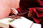 Monk holding prayer beads, Bodhgaya, Gaya, Bihar, India