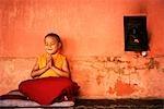 Boy praying in a temple, Bodhgaya, Gaya, Bihar, India
