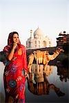 Woman standing with mausoleum in the background, Taj Mahal, Agra, Uttar Pradesh, India
