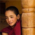 Child monk smiling in a monastery, Likir Monastery, Ladakh, Jammu and Kashmir, India