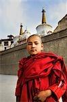 Child monk standing in front of a monastery, Lamayuru Monastery, Ladakh, Jammu and Kashmir, India