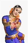 Woman performing Pushpaputam of Bharatnatyam