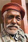 Portrait of a man smirking, Delhi, India