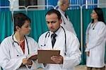 Doctors discussing a report, Gurgaon, Haryana, India