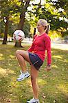 Woman Bouncing Soccer Ball on Knee, Green Lake Park, Seattle, Washington, USA