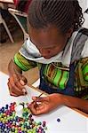 Woman Working with Kazuri Beads, Nairobi, Kenya