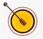 Honey dipper in bowl of honey