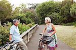 Mature couple having cycling break