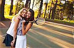 Two Young Women Playing Tennis