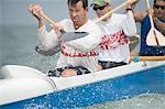 Outrigger canoeing team raise oars