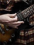 Close-up of Man Playing Electric Guitar