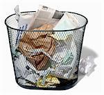 Wastepaper basket full of trash