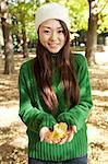 Woman holding fallen leaves