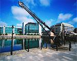 Ifsc, Dublin City, Ireland; Riverside Sculpture Against Cityscape