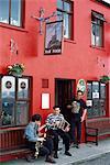 Co Cork,Ireland;Traditional Musicians Outside O'neill's Pub