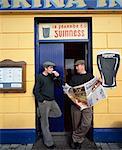 Dingle Town,Co Kerry,Ireland;Men Standing Outside Pub