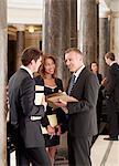 Smiling lawyers talking in corridor