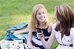 Two Girls Sitting on Grass
