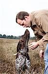 Dog Giving Owner a Kiss, Houston, Texas, USA