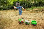 Boy Playing Outdoors, Domaine de l'Ardagnole, Fajac-en-Val, Aude, Languedoc-Roussillon, France
